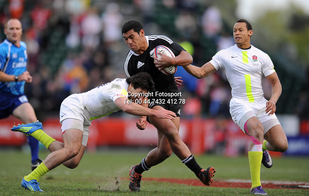 New Zealand's Salesi Piutau is tackled by England's Mat Turner.<br /> New Zealand v England, Cup Final, IRB Sevens World Series, round 8, Day 2, Scotstoun Stadium, Glasgow, Scotland, Sunday 6th May 2012.