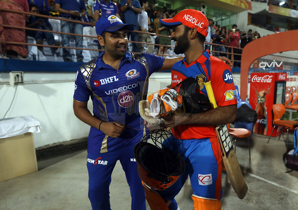 Mumbai Indians captain Rohit Sharma and Dinesh Karthik of the Gujarat Lions after the match 35 of the Vivo 2017 Indian Premier League between the Gujarat Lions and the Mumbai Indians  held at the Saurashtra Cricket Association Stadium in Rajkot, India on the 29th April 2017<br /> <br /> Photo by Sandeep Shetty - Sportzpics - IPL