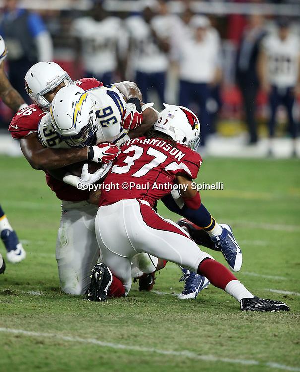 San Diego Chargers running back Dreamius Smith (36) gets gang tackled by Arizona Cardinals linebacker Kareem Martin (96) and Arizona Cardinals cornerback Shaquille Richardson (37) as he runs the ball during the 2015 NFL preseason football game against the Arizona Cardinals on Saturday, Aug. 22, 2015 in Glendale, Ariz. The Chargers won the game 22-19. (©Paul Anthony Spinelli)