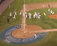 The Oregon State Beavers rush the field after the final out for the National Championship against North Carolina.  The Beavers beat the Tar Heels 3-2 for the National Championship at the College World Series at Rosenblatt Stadium in Omaha, Nebraska, June 26, 2006.