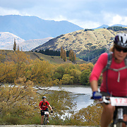 Tom Kirk (left) and Rosemary Lee (foreground) in action during the New World Tour de Wakatipu bike race on Saturday. Six hundred and ninety people entered the bike race which featured an  exclusive course with breathtaking views from Millbrook Resort in Arrowtown to Chard Farm along the Kawarau River, via the trails and tracks of the Wakatipu basin with distances of 36 kilometres fun riding for recreational bikers and 45 kilometres for elite and sport racers. The event was part of the inaugural Queenstown Bike Festival, which took place from 16th-25th April. The event hopes to highlight Queenstown's growing profile as one of the three leading biking centres in the world. Queenstown, Central Otago, New Zealand. 23rd April 2011. Photo Tim Clayton..