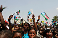South Sudanese celebrating at the official independence day ceremony. After decades of conflict, Southern Sudan declared independence from the North on July 9th, 2011. Government officials, foreign dignitaries and ordinary people came to the John Garang Memorial in the capital from all over the country and the world to celebrate the historic occation..Juba, South Sudan. 09/07/2011..Photo © J.B. Russell