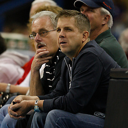 Apr 07, 2010; New Orleans, LA, USA; New Orleans Saints head coach Sean Payton (right) watches courtside with assistant coach Joe Vitt (left) during the first half of a game between the New Orleans Hornets and the Charlotte Bobcats at the New Orleans Arena. Mandatory Credit: Derick E. Hingle-US PRESSWIRE
