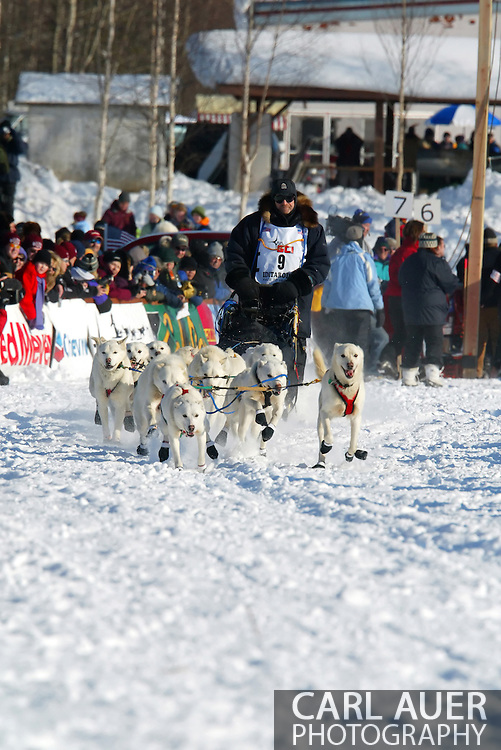 3/4/2007:  Willow, Alaska -  With an all white dog team, Veteran Jim Lanier of Chugiak, AK begins the long journey to Nome at the start of the 35th Iditarod Sled Dog Race