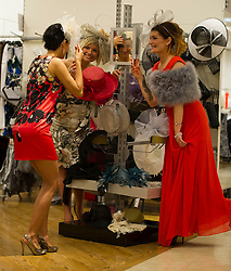 Eliza Swenarek, Dorota Drozdz and Kate Poddles try on hays after visiting Allure Medi Spa in Debenhams at Ocean Terminal to get ready for Ladies Day at Musselburgh Race Course. 11 June 2012 (Ger Harley | StockPix).