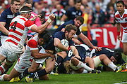 Scotland's captain Greig Laidlaw nearly reaches the try line during the Rugby World Cup Pool B match between Scotland and Japan at the Kingsholm Stadium, Gloucester, United Kingdom on 23 September 2015. Photo by Shane Healey.