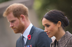 The Duke and Duchess of Sussex observe a minutes silence during a visit to the newly unveiled UK war memorial and Pukeahu National War Memorial Park, in Wellington, on day one of the royal couple's tour of New Zealand.