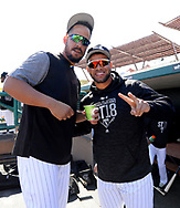 GLENDALE, ARIZONA - FEBRUARY 26:  Jose Abreu #79 and Yoan Moncada #10 of the Chicago White Sox have fun in the dugout prior to the game against the Oakland Athletics on February 26, 2018 at Camelback Ranch in Glendale Arizona.  (Photo by Ron Vesely)  Subject:   Jose Abreu; Yoan Moncada