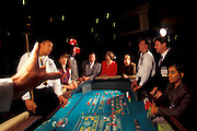 An excited group of people playing Crapps at  Caesar's Casino in Atlantic City, NJ.