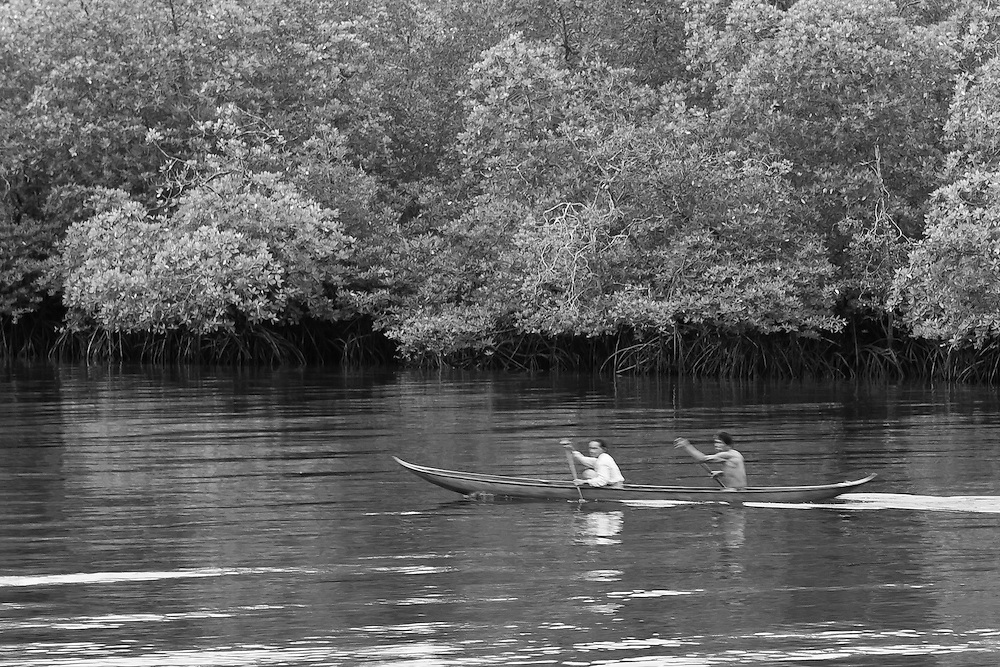 Black and White Photograph of Villagers' Morning Commute, Mentawai Islands, Indonesia (2006)