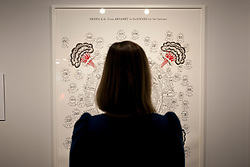 © licensed to London News Pictures. London, UK 06/03/2012. A woman looks at Suzanne Treister's Hexen 2.0 Diagrams. Treister applies new subjects and suggestions to the tarot format in her new exhibition at Science Museum, London. Photo credit: Tolga Akmen/LNP