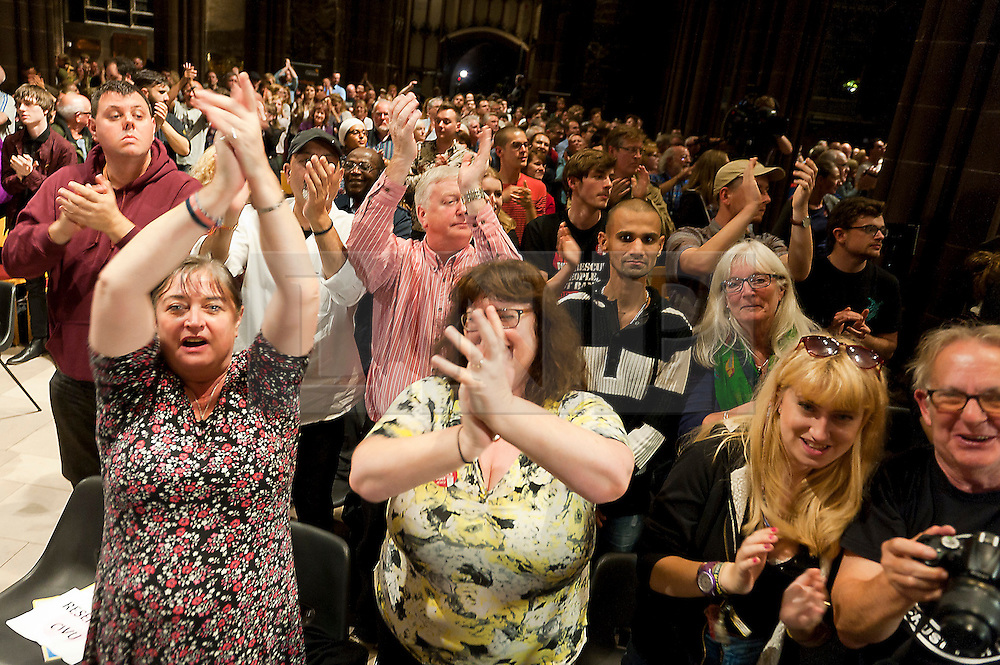 © Licensed to London News Pictures. 05/10/2015. Manchester, UK. Corby fans go wild after his speech. Jeremy Corbyn gives a rousing speech to several thousand fans in Manchester Cathedra on day four of the protest weekl. A week of pro-peace, anti-austerity, anti-war, anti-Tory, protests dubbed 'Take Back Manchester' has been  organised by The People's Assembly and timed to coincide with the Conservative Party Conference in Manchester on 4th - 7th Oct 2015. Over 40 events are planned, including a speech by new Labour leader Jeremy Corbyn timed to compete with closing speech of Tory leader David Cameron. Photo credit: Graham M. Lawrence/LNP