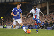 Everton defender Seamus Coleman and Crystal Palace defender Pape Souare  during the Barclays Premier League match between Everton and Crystal Palace at Goodison Park, Liverpool, England on 7 December 2015. Photo by Simon Davies.