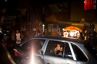 Rocinha residents drive through their neighborhood, in Rio de Janeiro, Br., on Thursday, Jan. 24, 2013. Rocinha is the biggest favela in Brazil, with over 100,000 residents. In early November 2011, about 3,000 police officers and soldiers moved into one of the largest slums in Latin America in an effort by the Brazilian government to assert control over lawless areas of the city ahead of the 2014 World Cup and 2016 Summer Olympics.