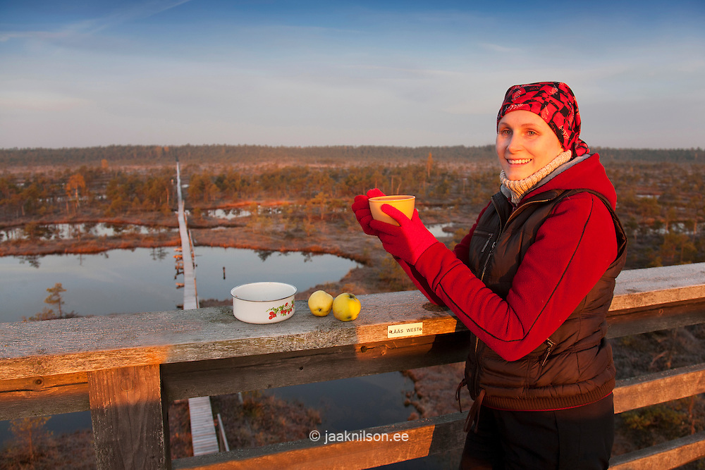 Young Woman Having Breakfast in Männikjärve Bog, Jõgeva County, Estonia