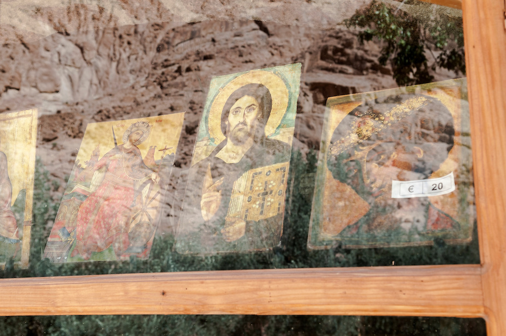 The barren mountains of Sinai are reflected in a gift shop window at St. Catherine's Monastery, a Christian landmark built in the sixth century in the Sinai Peninsula, Egypt. Icons are on display in the window.