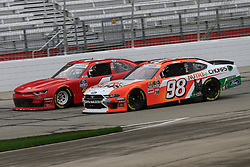 February 23, 2019 - Hampton, GA, U.S. - HAMPTON, GA - FEBRUARY 23: #4: Ross Chastain, JD Motorsports, Chevrolet Camaro teamjdmotorsports.com battles #98: Chase Briscoe, Stewart-Haas Racing, Ford Mustang Nutri Chomps for position during the Rinnai 250 on February 23, 2019 at the Atlanta Motor Speedway in Hampton, GA.  (Photo by David J. Griffin/Icon Sportswire) (Credit Image: © David J. Griffin/Icon SMI via ZUMA Press)