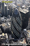 aerial photograph of 30 St Mary Axe / the Gerkin  in the City of London England UK