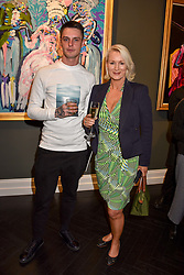 Danny Baldwin and Friederike Krum at a private view of work by Bradley Theodore entitled 'The Second Coming' at the Maddox Gallery, 9 Maddox Street, London England. 19 April 2017.