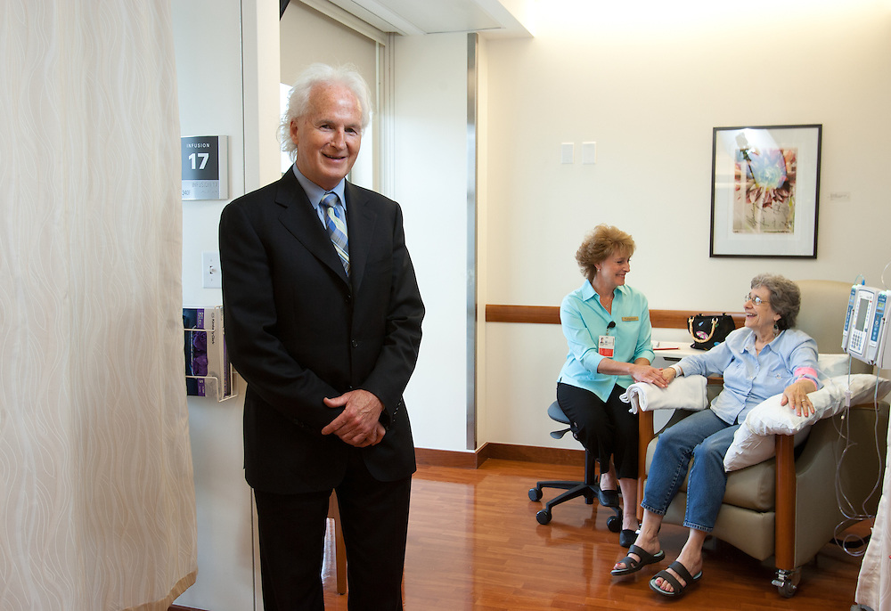Weymouth, MA 06/20/2011.Paul Sullivan of Sullivan Tire, with South Shore Hospital volunteer Lisa Battista and patient Janet Stover..Alex Jones / www.alexjonesphoto.com