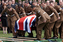 © Licensed to London News Pictures. 19/04/2012. DIDCOT, UK. The coffin is carried during funeral of Lance Corporal Michael Foley, Adjutant General's Corps (Staff and Personnel Support). He was shot dead by an Afghan soldier on March 26. He is survived by his wife Sophie (not pictured) and their three young sons who did not attend the service. Photo credit :  Cliff Hide/LNP
