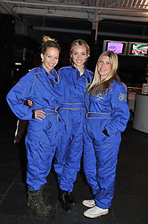 Left to right, MARISSA HERMER, NOELLE RENO and JESS PENNACHETTI at a Girl Karting - a charity Go-Karting evening in aid of Too Many Women held at The Raceway, 3 Herringham Road, London SE7 on 12th September 2012.