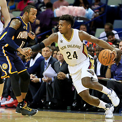Oct 4, 2016; New Orleans, LA, USA;  New Orleans Pelicans guard Buddy Hield (24) drives past Indiana Pacers guard Monta Ellis (11) during the first quarter of a game at the Smoothie King Center. Mandatory Credit: Derick E. Hingle-USA TODAY Sports
