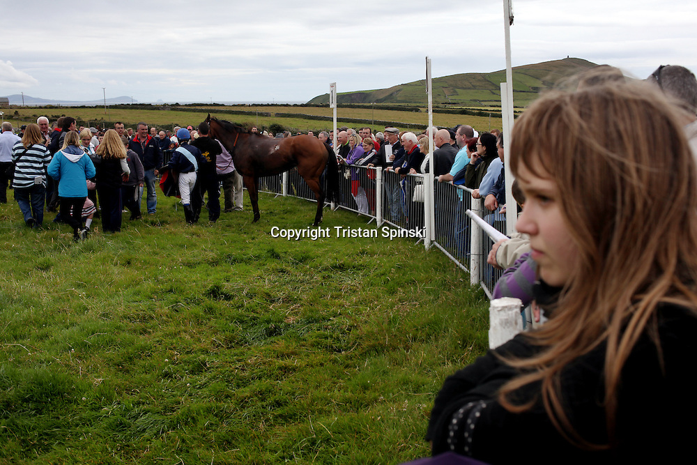 "Fans gather to watch the jockeys and their horses enter the ""winners circle"" during annual Dingle Races, the largest flapper races in Ireland, during the first day of the weekend-long event in Dingle, Ireland."
