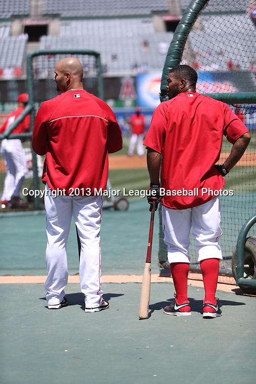ANAHEIM, CA - JUNE 15:  (L-R) Albert Pujols #5 of the Los Angeles Angels of Anaheim watches batting practice with Howie Kendrick #47 of the Los Angeles Angels of Anaheim before the game against the New York Yankees on Saturday, June 15, 2013 at Angel Stadium in Anaheim, California. The Angels won the game 6-2. (Photo by Paul Spinelli/MLB Photos via Getty Images) *** Local Caption *** Albert Pujols;Howie Kendrick