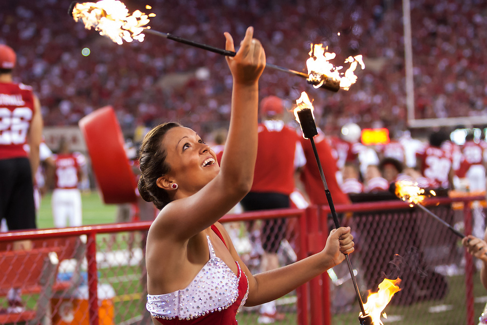 September 7, 2013: Nebraska baton twirler twirling with fire during the game against the Southern Miss Golden Eagles at Memorial Stadium in Lincoln, Nebraska. at Memorial Stadium in Lincoln, Nebraska.
