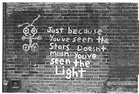 """Just because you've seen the stars doesn't mean you've seen the light"", graffiti painted on a brick wall, South-East London, London street photography in 1982. Tri-X"