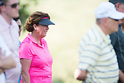 Cathy Marino, Jordan's high school golf coach, watches during the first round of the AT&T Byron Nelson in Las Colinas, Texas on May 28, 2015. (Cooper Neill for The New York Times)