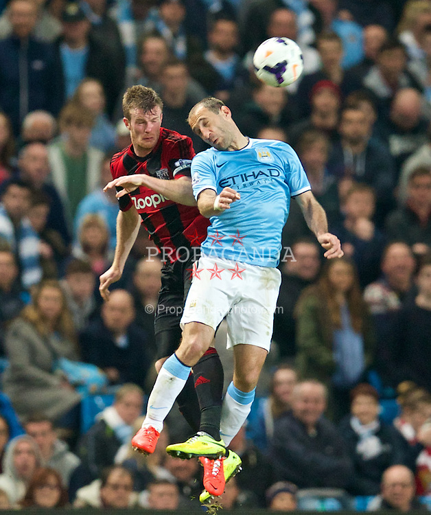 MANCHESTER, ENGLAND - Easter Monday, April 21, 2014: Manchester City's Pablo Zabaleta in action against West Bromwich Albion's captain Chris Brunt during the Premiership match at the City of Manchester Stadium. (Pic by David Rawcliffe/Propaganda)