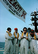 U2 Band  on a boat trip to a radioactive Sellafield beach dressed in anti radiation suits for a 1992 Greenpeace Demo.
