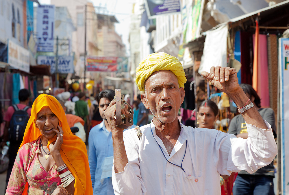 Man and woman singing as they enter Pushkar for the Pushkar Pilgrimage.  Every year, Pilgrims come to Pushkar to offer pujas to the Gods.