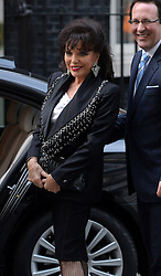 Joan Collins and Percy Gibson arrive at 10 Downing Street, London, UK, for a reception to celebrate inspirational women.<br />  Thursday, 6th March 2014. Picture by Ben Stevens / i-Images