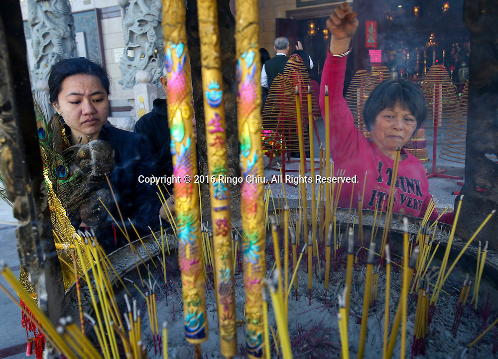 People burn incense at the Thien Hau temple to celebrate the first day of the Chinese Lunar New Year, the Year of the Monkey, on Monday February 8, 2016, in Los Angeles(Photo by Ringo Chiu/PHOTOFORMULA.com)<br /> <br /> Usage Notes: This content is intended for editorial use only. For other uses, additional clearances may be required.