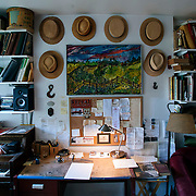 May 10, 2012 - Brooklyn, NY : The living room in musician and composer Michael Arenella's apartment on Douglas Street in Brooklyn is adorned with a collection of hats, musical instruments, books, and a painting by his father, Joe Arenella. CREDIT : Karsten Moran for The New York Times