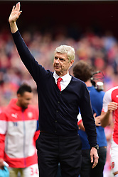 Arsenal manager Arsene Wenger waves to the crowd after the Barclays Premier League match at the Emirates Stadium, London.
