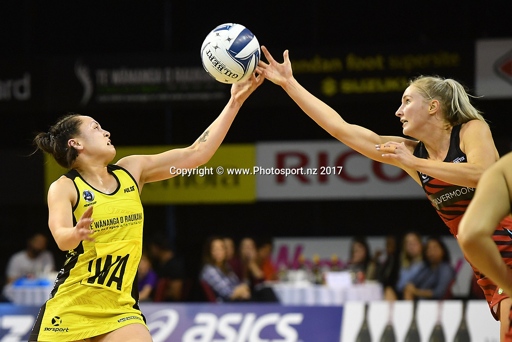 Pulse's Whitney Souness Tactix's Hayley Saunders (R fight for possession during the ANZ Premiership netball match between the Wellington Pulse vs Mainland Tactix at TSB Arena in Wellington on Sunday the 9th of April 2017. Copyright Photo by Marty Melville / www.Photosport.nz