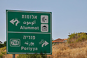 Israel, Galilee a road sign in English, Arabic and Hebrew directing to Alummot and Poriya