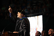 Dr. Michael Sweeney speaks at graduate commencement. Photo by Ben Siegel