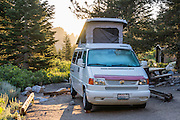 Volkswagon Eurovan Camper in Onion Valley Campground at sunrise in the Sierra Nevada west of Independence, California, USA. A spectacular hike leads from here through John Muir Wilderness in Inyo National Forest over Kearsarge Pass into Kings Canyon National Park.