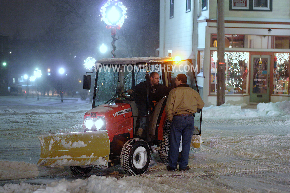 Middletown, NY - A public works employee plowing snow stops to talk to a supervisor  during a winter storm on the night of Dec. 19, 2008.