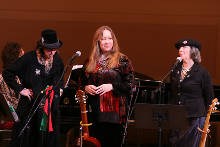 Sloan (sp?) Wainwright (center) with Kate McGarrigle (on left) and Anna McGarrigle at Carnegie Hall on December 22, 2005.in a show titled &quot;A McGarrigle Christmas. Sloan  Wainwright (center) with Kate McGarrigle (on left) and Anna McGarrigle at Carnegie Hall on December 22, 2005.in a show titled &quot;A McGarrigle Christmas.<br />