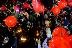 Black and red balloons go up as fans, friends and family mourn the death of Akeem Mickens (professionally known as battle rapper Tech9) during a vigil at the Happy Hollow playground, in Germantown, on Tuesday. (Bastiaan Slabbers for WHYY)