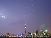 http://Duncan.co/cn-tower-lightning/<br /> <br /> A lightning strike at the CN Tower. Shot from the island across the harbour.