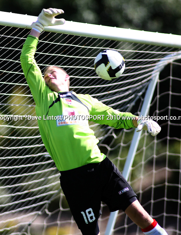 The ball rebounds off the bar behind Canterbury keeper Tom Batty .<br /> NZFC soccer  - Team Wellington v Canterbury United at Porirua Park, Wellington. Sunday, 14 March 2010. Photo: Dave Lintott/PHOTOSPORT