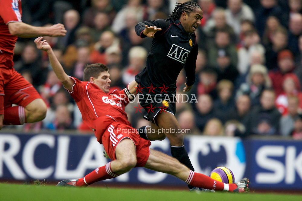 LIVERPOOL, ENGLAND - Sunday, December 16, 2007: Liverpool's captain Steven Gerrard MBE tackles Manchester UnitedOliveira Anderson during the Premiership match at Anfield. (Photo by David Rawcliffe/Propaganda)