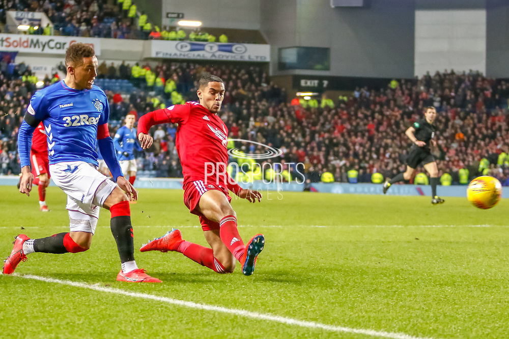 James Tavernier (C) crosses the ball during the William Hill Scottish Cup quarter final replay match between Rangers and Aberdeen at Ibrox, Glasgow, Scotland on 12 March 2019.